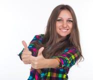 La ragazza mostra due pollici Fotografia Stock