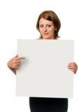 La ragazza mostra la scheda in bianco Fotografia Stock Libera da Diritti