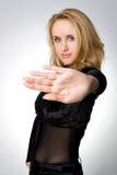La ragazza mostra la sua palma Fotografie Stock