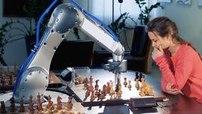 La ragazza muove la figura di scacchi che gioca con un robot automatizzato moderno di scacchi 4K video d archivio