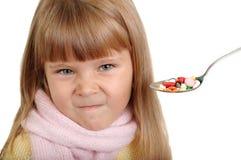 La ragazza non vuole le pillole Fotografia Stock