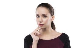 La ragazza pensa isolato su bianco Fotografia Stock