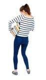 La ragazza porta un mucchio pesante dei libri Vista posteriore Fotografia Stock Libera da Diritti