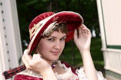 La ragazza registra il cappello Fotografie Stock Libere da Diritti
