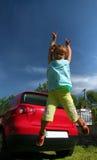 La ragazza salta Immagine Stock