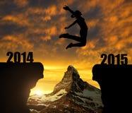 La ragazza salta al nuovo anno 2015 Fotografie Stock