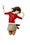 La ragazza salta con la gioia (pattini nel movimento Fotografie Stock