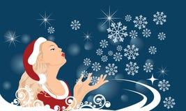La ragazza scarica i fiocchi di neve dalla mano Immagine Stock