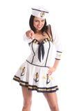 La ragazza sexy del marinaio delle forze munite di divertimento indica alla macchina fotografica Fotografia Stock Libera da Diritti