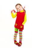 La ragazza si è vestita in rosso e nel colore giallo 2 Immagine Stock