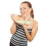 La ragazza sorride e mangia l'alimento dietetico Immagini Stock Libere da Diritti