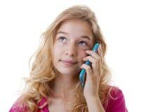 La ragazza sta rivolgendo a loking del telefono cellulare triste Fotografia Stock Libera da Diritti