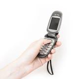 La ragazza sta tenendo il retro telefono cellulare disponibile di Flip-flop Immagine Stock