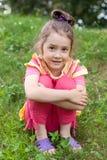 La ragazza su un'erba Fotografia Stock