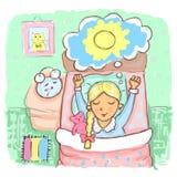 La ragazza sveglia prima della sveglia Fotografie Stock