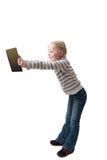 La ragazza tiene il libro in braccia outstretched Fotografia Stock Libera da Diritti