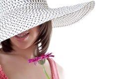 La ragazza in un cappello Fotografia Stock