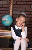 La ragazza in un uniforme scolastico Fotografia Stock Libera da Diritti