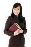 La ragazza in un vestito con i libri Fotografia Stock