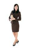 La ragazza in un vestito di affari con i libri Fotografia Stock