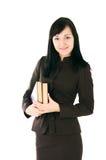 La ragazza in un vestito di affari con i libri Immagine Stock