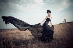 La ragazza in un vestito gotico Immagine Stock Libera da Diritti