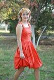 La ragazza in un vestito rosso 2 Fotografia Stock