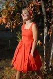 La ragazza in un vestito rosso 4 Fotografia Stock Libera da Diritti