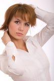 La ragazza in una camicia bianca fotografia stock libera da diritti