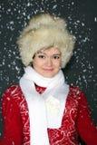 La ragazza in una protezione della pelliccia in neve Fotografia Stock Libera da Diritti