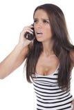 La ragazza urla sul telefono Immagine Stock Libera da Diritti