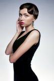 La ragazza in vestito nero Fotografia Stock