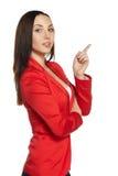La ragazza in vestito rosso mostra il pollice Immagini Stock