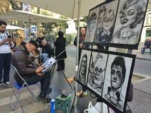 La Rambla, Barcelona, em dezembro de 2015 caricatura do desenho do artista da rua do homem Fotos de Stock Royalty Free
