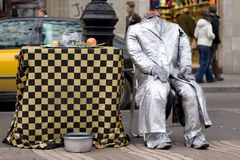 La Rambla, Barcelona, Spain. Street artist, scene of suicide Stock Photography