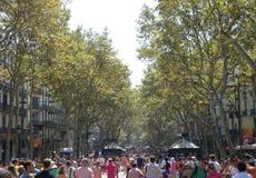 La Rambla - Barcelona. Tourists walking through La Rambla in Barcelona Stock Images