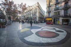 La Rambla, mosaic in pavement, by Joan Miro, located in Pla de la Boqueria, Barcelona. Stock Photo