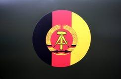 La RDA - drapeau et manteau-de-bras Image stock
