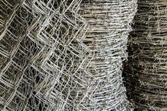 Rollo de la red del alambre de púas y del hierro Fotografía de archivo libre de regalías
