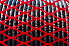 La red y la cuerda rojas de la falta de definición del primero plano del diseño lanzan el fondo de la grúa con una honda Imagen de archivo libre de regalías