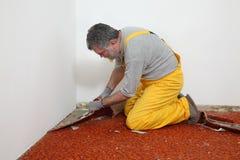 La renovación casera, alfombra quita Fotos de archivo libres de regalías