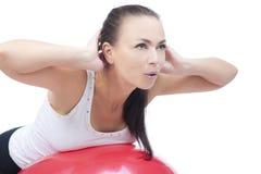 La respiración profunda y abomen el entrenamiento del ejercicio Foto de archivo