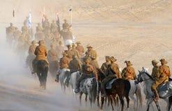 La ricreazione della tassa di cavalleria 100 anni di ANZAC Immagini Stock