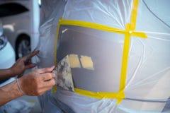 La riparazione rapida della pittura dell'automobile, richiede un'- due ore immagine stock libera da diritti