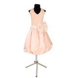 La robe des enfants sur un simulacre Photo stock