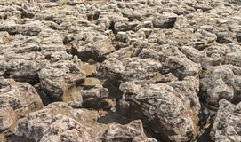 La roccia è stata erosa da pioggia, il vento, l'acqua, per fa il fondo Fotografie Stock Libere da Diritti