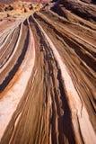 La roccia Curverture nell'onda Immagine Stock Libera da Diritti