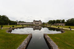 La Roche Courbon castle pool and reflections. La Roche Courbon  castle in charente maritime region of France Stock Photo