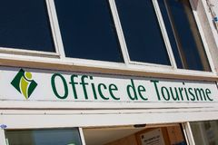 A business sign for the Office of Tourism (Office de Tourisme. La Rochelle, France - August 22, 2016: Closeup of sign - Office of Tourism (Office de Tourisme in Stock Photo