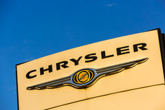 La rochelle, France - August 30, 2016: Official dealership sign of Chrysler against the blue sky. Chrysler is the American subsidi Royalty Free Stock Images
